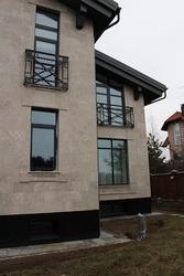 Дерево-алюминиевые окна из лиственницы с Белоруссии